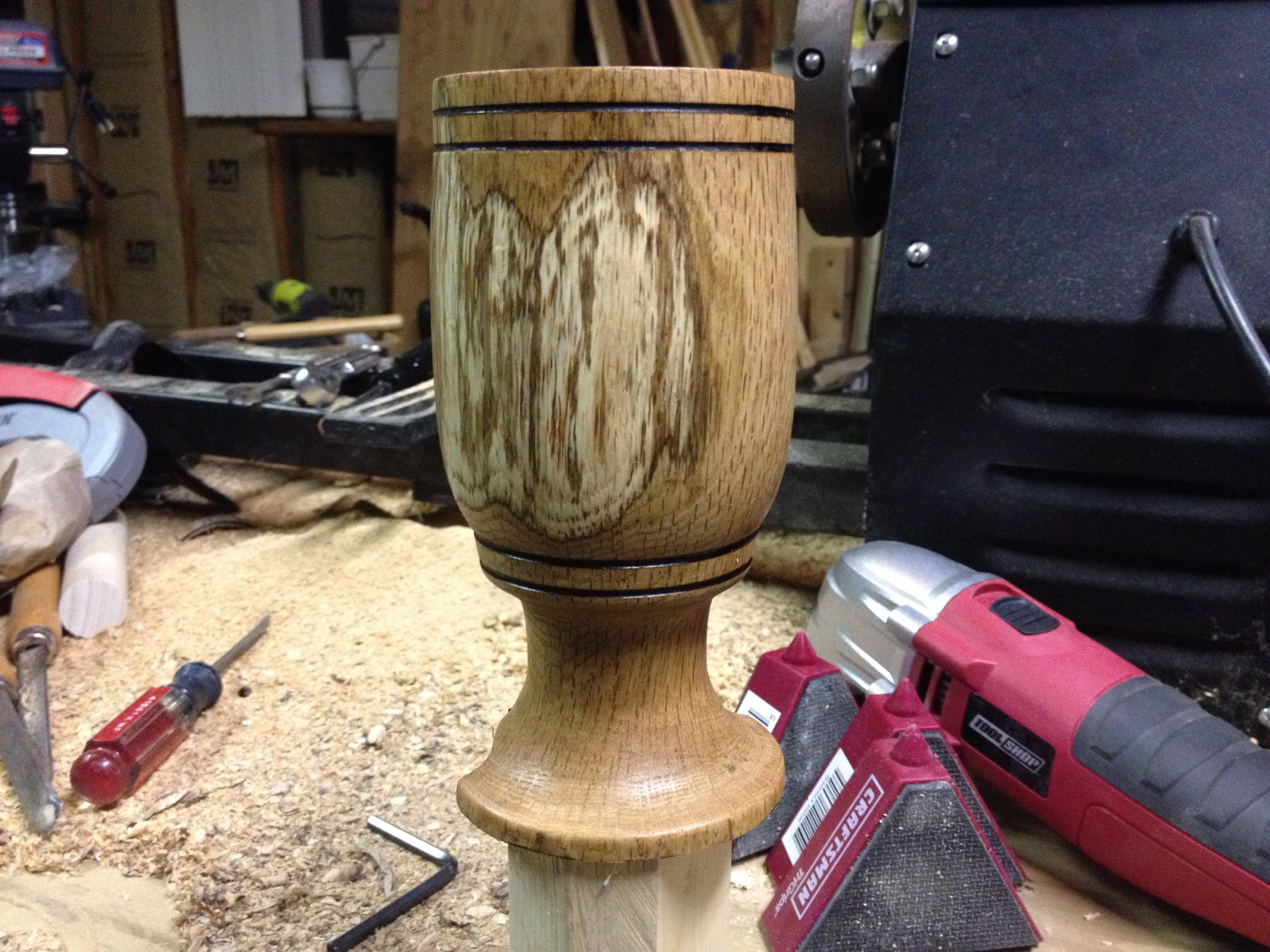 The oak water goblet is off of the lathe and got a clear coat added.